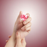 Hand holding 3d red heart shape of diamond Royalty Free Stock Photos