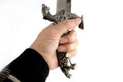 Hand holding dagger Royalty Free Stock Photography