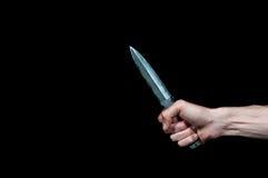 A hand holding dagger Stock Photos