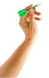 Hand holding dart Stock Image