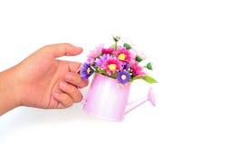 Hand holding decorative flower Stock Image
