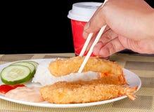 Hand holding Deep Fried Shrimps Ebi Tempura and Rice Asian Food. Deep Fried Shrimps Ebi Tempura and Rice Asian Food Royalty Free Stock Photo