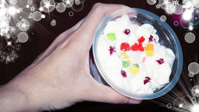 Hand holding delicious dessert with bokeh background Stock Photo