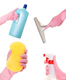 Hand holding a detergent, liquid, squeegee and sponge Stock Photos