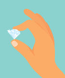 Hand holding a diamond Royalty Free Stock Photography
