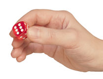Hand holding a dice Stock Photo