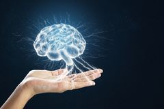 Hand holding digital brain. On blue background. Science concept royalty free stock photo