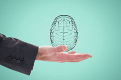 Hand holding a digital brain with green background Stock Photography