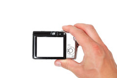 Hand holding digital camera Stock Images