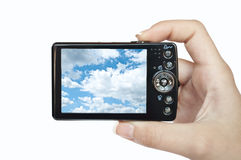 Hand holding digital camera with picture of sky Royalty Free Stock Images