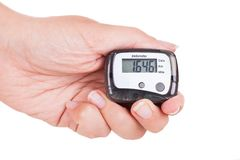 Hand Holding Digital Pedometer Stock Photo