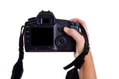 Hand holding digital photo camera Royalty Free Stock Images