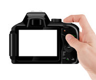Hand holding digital SLR camera Stock Images