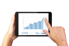 Hand holding digital tablet with business graph on display Royalty Free Stock Photography