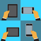 Hand holding digital tablet and cellphone,vector illustration in flat design for web sites Stock Images