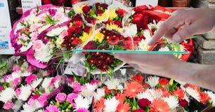 Hand holding digital tablet at flower shop Stock Image