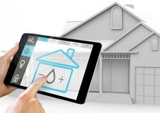 Hand holding digital tablet with home security icons on screen Stock Photo