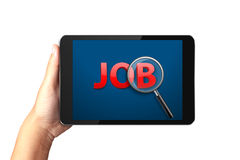 Hand holding digital tablet with Job search on display. Stock Photos