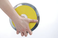 Hand holding the discus. Against a white background Royalty Free Stock Photo