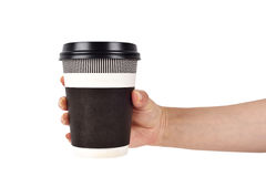 Hand holding disposable coffee cup Stock Photography
