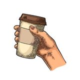 Hand holding a disposable cup of coffee with cardboard holder and cap. Royalty Free Stock Photos