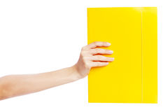 Hand holding a document. White background Royalty Free Stock Photography
