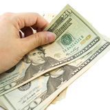 Hand holding dollar bill . Hand holding dollar bill with white background Royalty Free Stock Photos