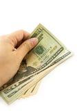 Hand holding dollar bill . Stock Image