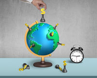Hand holding dollar chess on 3d map globe with clock. Hand holding dollar chess on 3d map terrestrial globe with alarm clock and concrete wall Stock Image