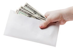 Hand holding dollar envelope Royalty Free Stock Photography