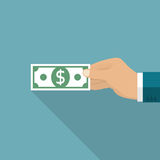 Hand holding dollar. Giving money. Hand holding dollar. Money in hand  on white background. Vector illustration, flat design style. Giving money Stock Photo