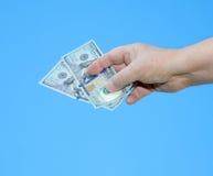 Hand holding dollar notes Stock Photo