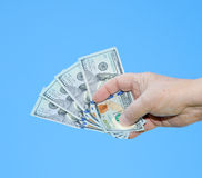 Hand holding dollar notes Stock Photography