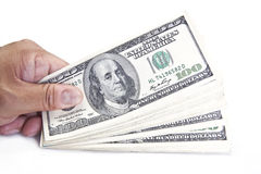 Hand Holding Dollar Stack Royalty Free Stock Photos