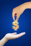 Hand holding dollar symbol Stock Photography