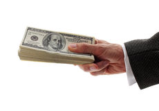 Hand holding dollars. Hand holding pile of dollars Stock Photos