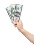 Hand holding dollars. Hand holding tree hundred US dollars, isolated, clipping path Royalty Free Stock Photography