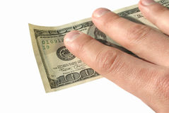 Hand holding dollars. A hand holding a $100 note, background is pure white, an ideal for finance designs Royalty Free Stock Image