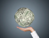 Hand holding dollars ball Stock Image