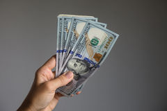 Hand holding dollars banknotes. Royalty Free Stock Images