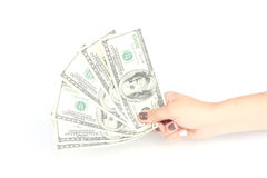 Hand holding 100 dollars on white. Dollars in a hand on white background Stock Image