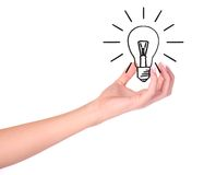 Hand holding drawn light bulb. Ecology/Environment concept Royalty Free Stock Image