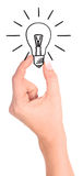 Hand holding drawn light bulb Stock Photography