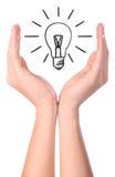 Hand holding drawn light bulb Royalty Free Stock Photos