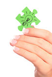 Hand holding drawn light bulb on puzzle royalty free stock images