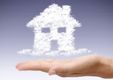 Hand holding dream home Stock Images