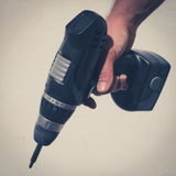 Hand holding drilling machine , electric screwdriver Stock Photography