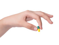 Hand holding Drug capsule on white Stock Images