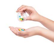 Hand holding Drug capsule on white Stock Image