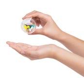 Hand holding Drug capsule on white background Royalty Free Stock Photos